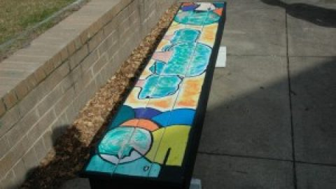Senior art class decorates courtyard benches