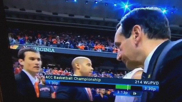 Foley shaking hands with coach Krzyzewski on national television.