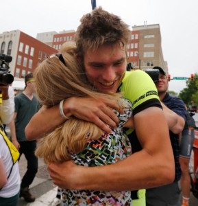 Chris Jones hugs his mom, Susan Mitchell, after winning the Collegiate Road Cycling Championships Time Trials on May 4.