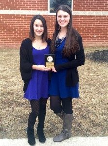 Seniors Nikki Wheeler and Megan Johnson outside the FEA competition with their second place award