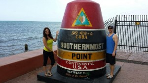 Math Teacher Bryan Cole standing next to the southernmost point of the continental USA.