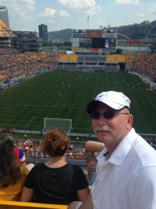 English teacher Chip Carter watches the United States Women's National Soccer Team on their victory tour in Pittsburgh, Pennsylvania.