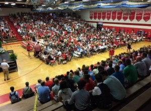 The Godwin gym fills up as students arrive to celebrate the life of their teacher, coach, and friend Todd Phillips