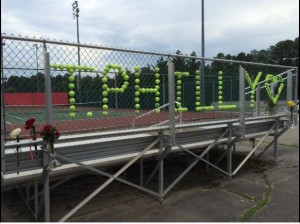 A memorial for Todd Phillips is created by the Godwin Tennis team in honor of their coach