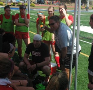Girls soccer coach Ali Toole gives her team a pep talk during a time out