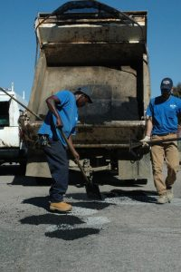 Photo Julia Grossman  Henrico County workers fill in the potholes