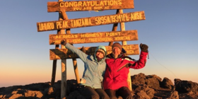 Wheeler and her dad celebrating after their eight day journey to the summit of Mount Kilimanjaro.  photo courtesy Molly Wheeler